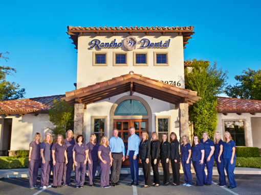 A photo of the entire Rancho Dental team in the front of the dental office
